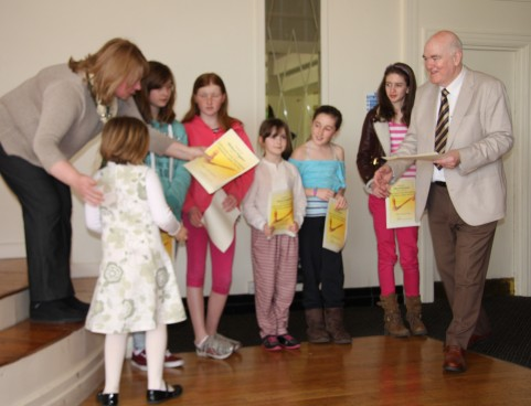 Leinster Chess Union President, Charlie Talbot, presents the Leinster Ladies with their certificates
